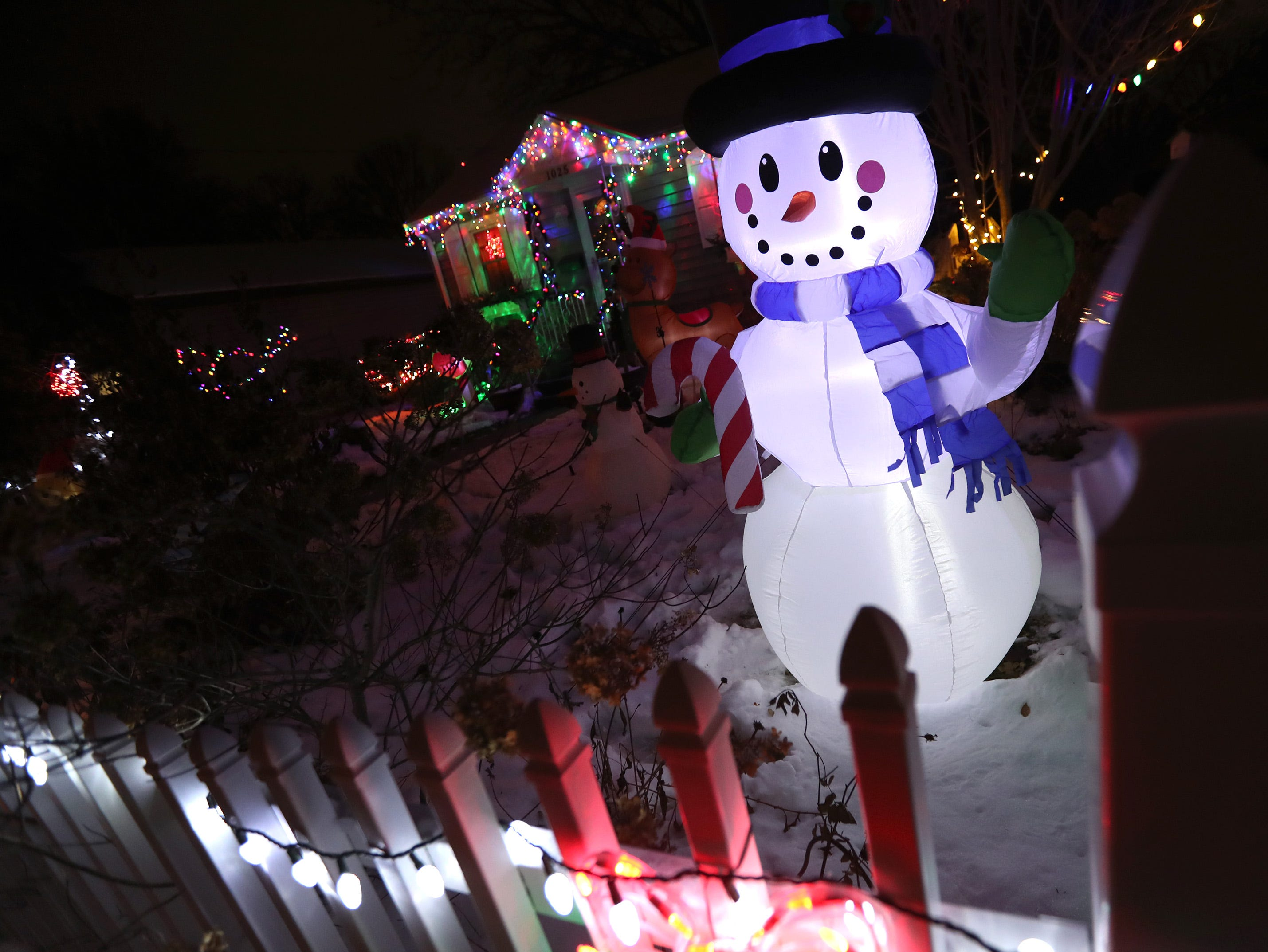 A blowup snowman and a collection of Christmas lights decorate a yard on the 1000 Block of South Kernan Avenue Wednesday Dec. 5, 2018, in Appleton, Wis.