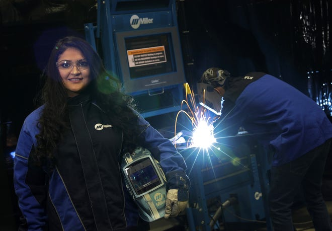 Olivia Arreola, a student at Fox Valley Technical College, will be the first person to graduate after benefiting from the school's Promise program, which pays for costs not covered by other financial aid. Arreola is also an intern at Miller Electric.