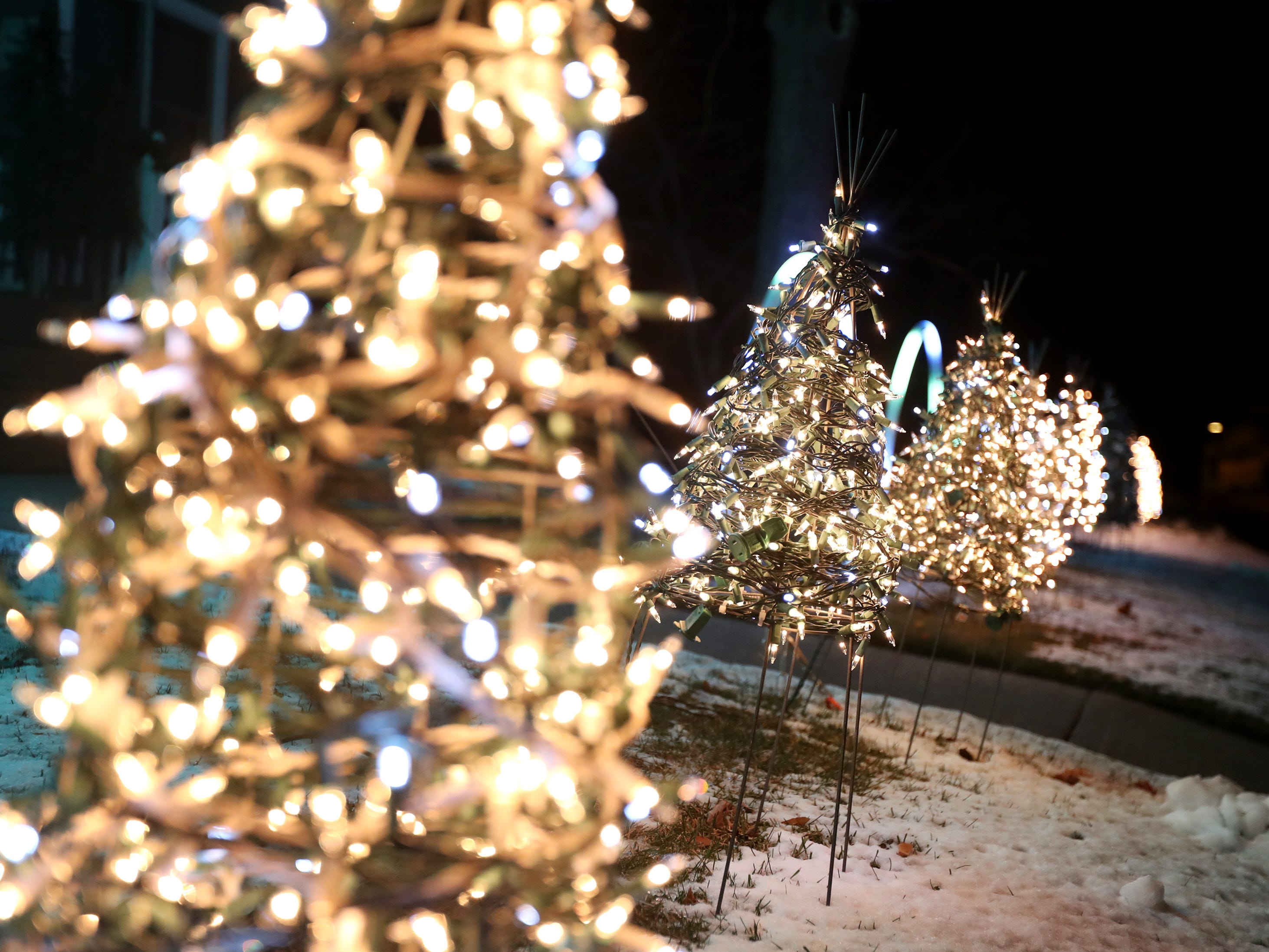 Christmas lights that are in sync with Christmas music are on display in front of a home on the 100 block of South Birch Street Wednesday Dec. 5, 2018, in Kimberly, Wis.