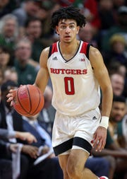 Rutgers Scarlet Knights guard Geo Baker (0) dribbles during the second half at against the Michigan State Spartans Rutgers Athletic Center.