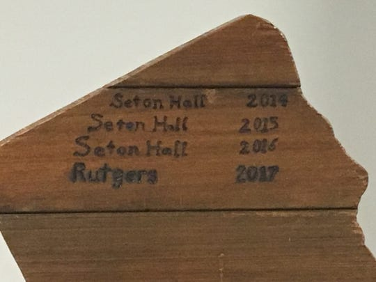 The winners' inscriptions on the back of the Boardwalk Trophy.