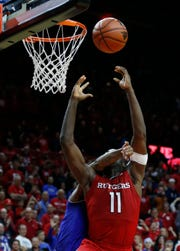 Rutgers Scarlet Knights forward Eugene Omoruyi (11) is fouled by Seton Hall Pirates guard Myles Powell (13) during the 2017 game.