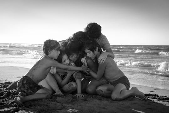 "Marco Graf as Pepe, from left, Daniela Demesa as Sofi, Yalitza Aparicio as Cleo, Marina De Tavira as Sofia, Diego Cortina Autrey as Toño, Carlos Peralta Jacobson as Paco in ""Roma,"" written and directed by Alfonso Cuarón."