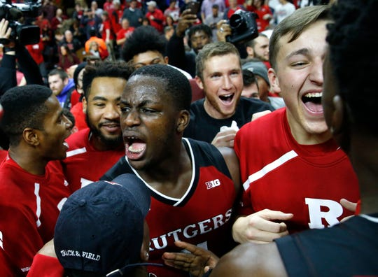 Rutgers Scarlet Knights forward Eugene Omoruyi (11) celebrates with fans after defeating Seton Hall at the RAC.