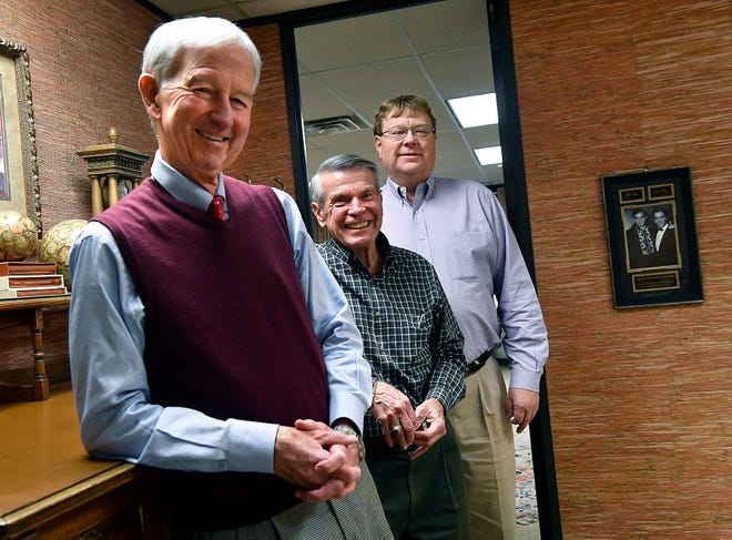 Dodge Jones Foundation Executive Director Joe Ed Canon (left), Grants Administrator Larry Gill and Kade Matthews, son of Judy Matthews Thursday at the foundation offices in downtown Abilene, beside a photograph of Johnny Cash and Elvis Presley.