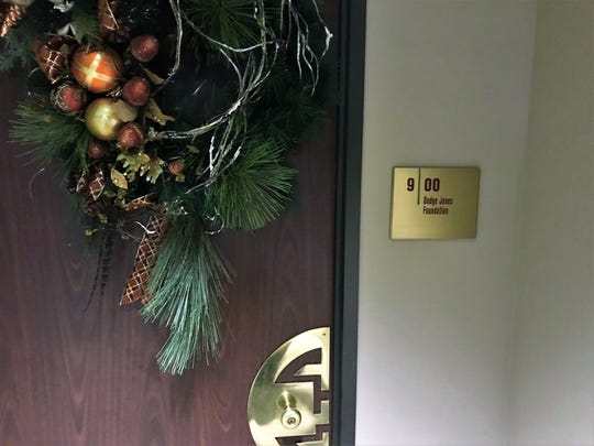 The entrance to the Dodge Jones Foundation on the ninth floor of the First Financial Bank building downtown is noted only by a simple plaque.