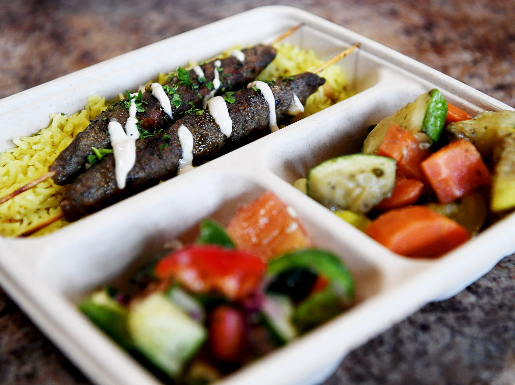 Mr. Kabab's kofta kabab comes with rice, vegetables and salad.