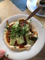 Hummus shakshuka at a market in Tel Aviv.
