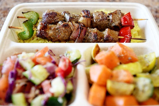 Mr. Kabab's marinated boneless lamb kabab served with rice, vegetables and fattoush Dec. 11, 2018.