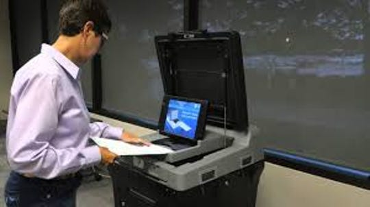 Madison County voters will fill out a paper ballot and insert it into an optical scanner and tabulation machine beginning with the 2019 municipal elections