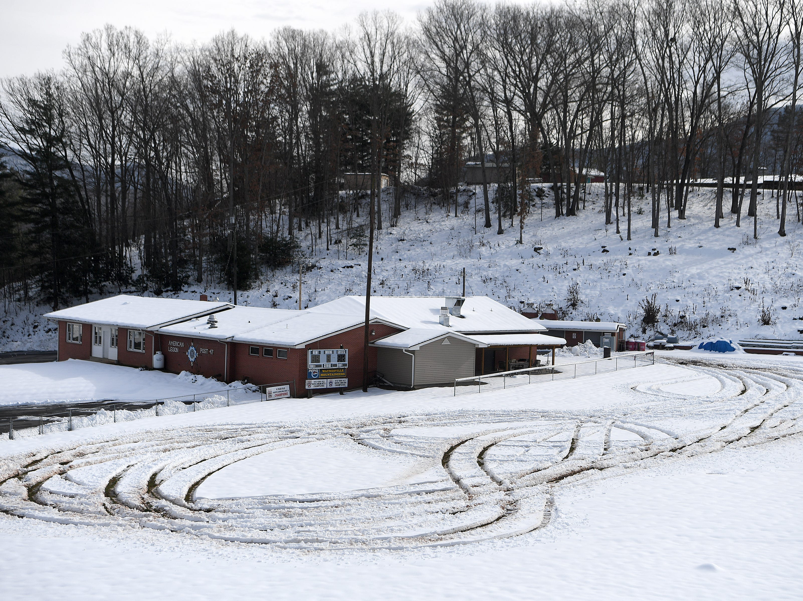 Tire tracks are seen in the snow at the American Legion ballpark in Waynesville following the weekend's snow on Dec. 12, 2018.