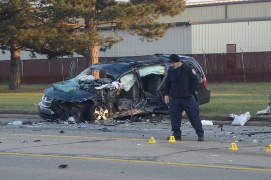 Police investigate the scene of a crash which critically injured a woman driving this van.
