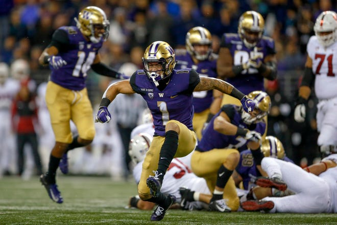 Washington cornerback Byron Murphy celebrates a third-down stop during a win over Stanford last month at Husky Stadium. Murphy says the Huskies' star-studded defensive backfield looks forward to facing Ohio State's high-powered offense in the Rose Bowl.