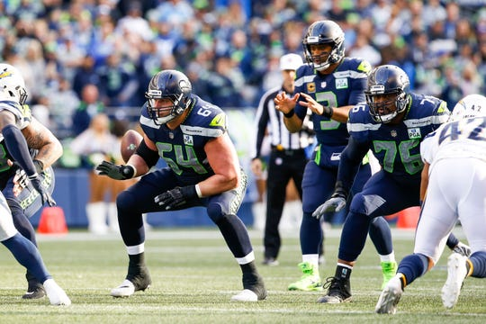 Seahawks linemen J.R. Sweezy (left) and Duane Brown block against the Los Angeles Chargers during a November game at CenturyLink Field.