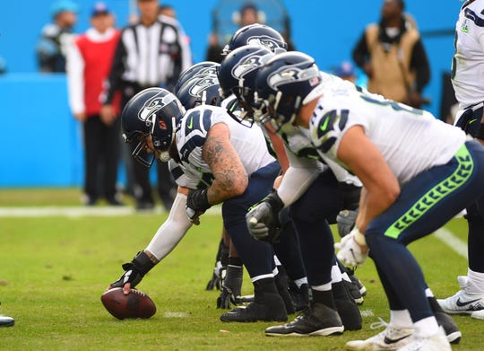 Center Justin Britt and the Seahawks offensive line before a play against the Panthers last month.