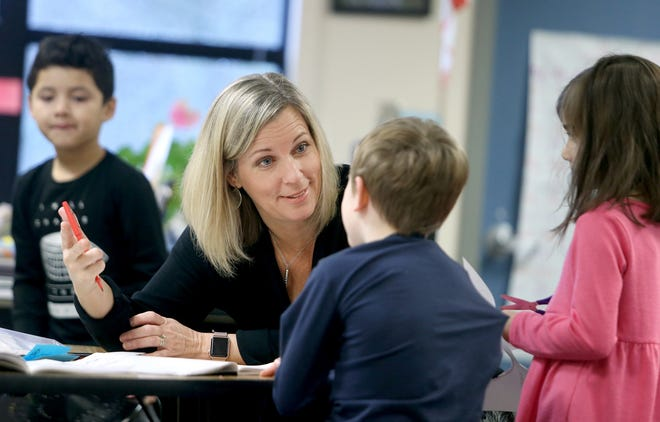 Stacy Loverich, a first-grade teacher at Poulsbo Elementary, helps a student.