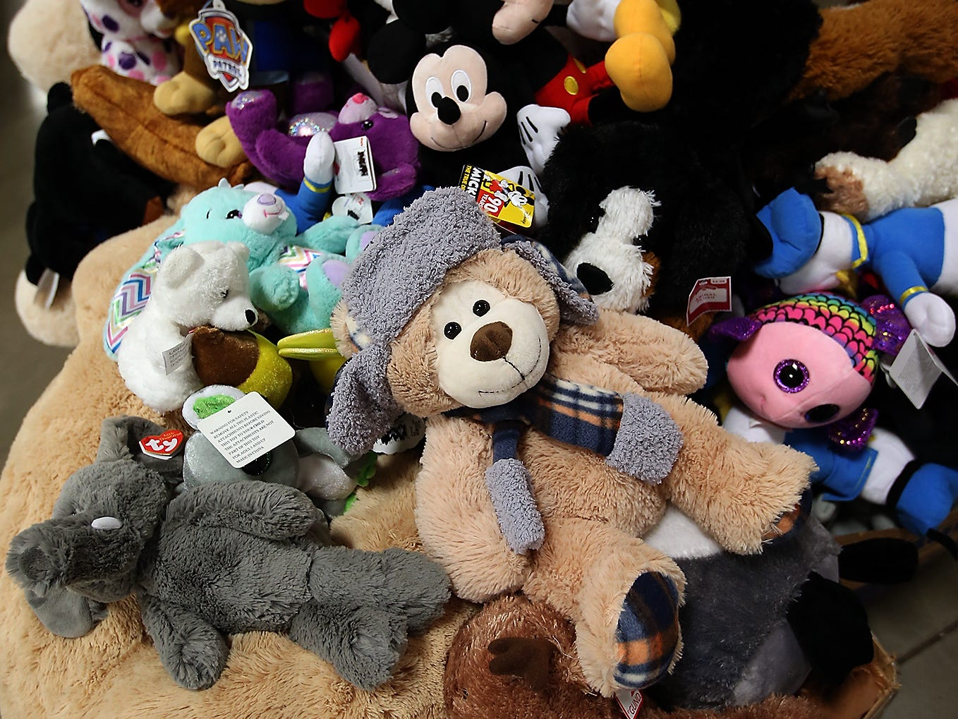 Stuffed animals of all shape and sizes await the upcoming Toys For Tots event in President's Hall at the Kitsap County Fairgrounds on Wednesday, December 12, 2018.
