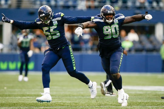 Frank Clark (left) and Jarran Reed are the new leaders of the Seahawks' defensive line.