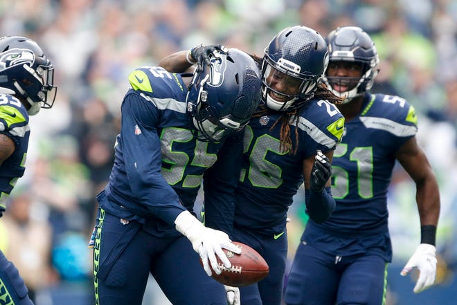 Frank Clark (left) and Shaquill Griffin are among the leaders of the Seahawks' young defense.
