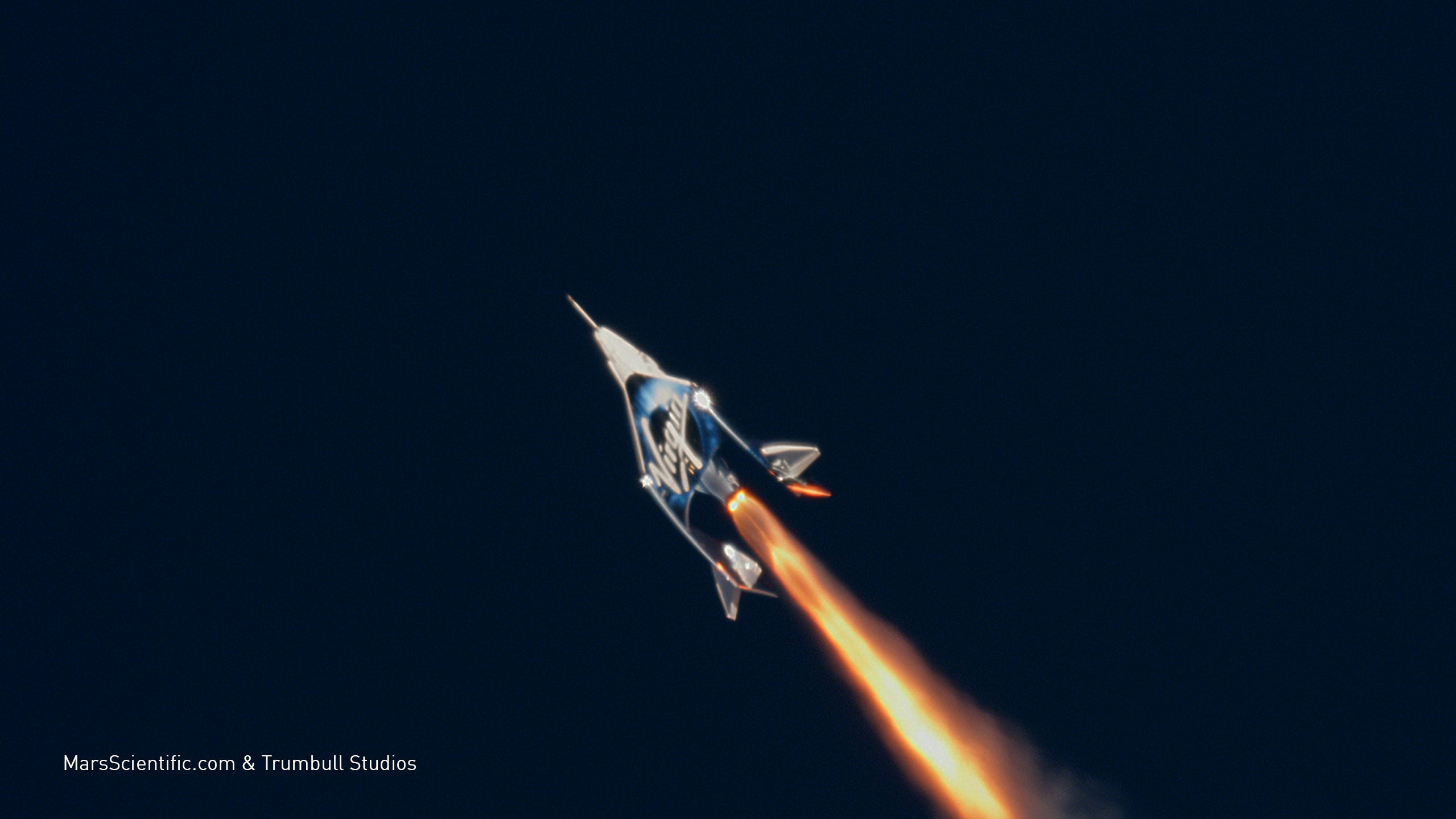 A pair of test pilots aboard Virgin Galactic's...