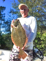 Mike Oyler of Melbourne caught this 8-pound Southern flounder while using a live finger mullet during an incoming tide at Sebastian Inlet. Anglers are hopeful that a good start to this season's winter run of the flatfish will continue through December and into January.