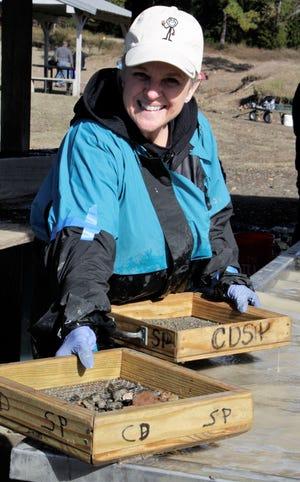 Lisa Johnston digs for precious stones at Crater of Diamonds in Arkansas.