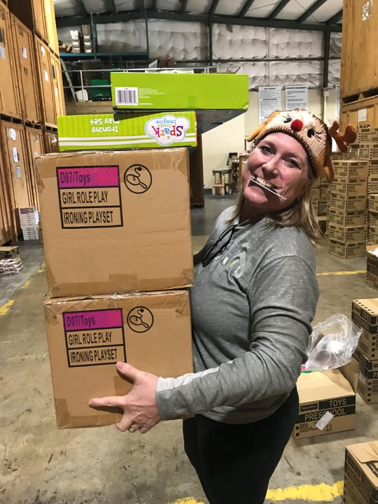 My co-worker Gina Kaiser was lead elf recently as a group of volunteers sorted Reaching Out Holiday Fund toys at Sorensen Moving and Storage.