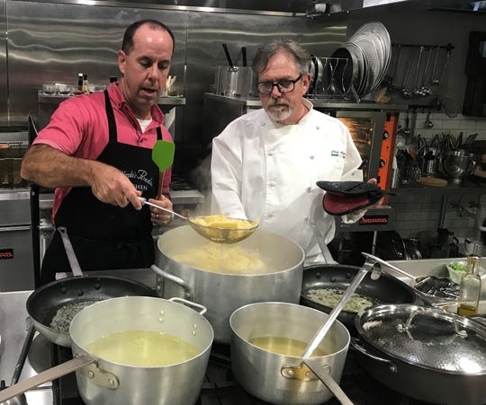 Steve Leonard, left, dips fresh-made ravioli out of a steaming pot under the watchful eyes of chef Alfredo Giulio at Alfredo's Paradiso Kitchen on Merritt Island.