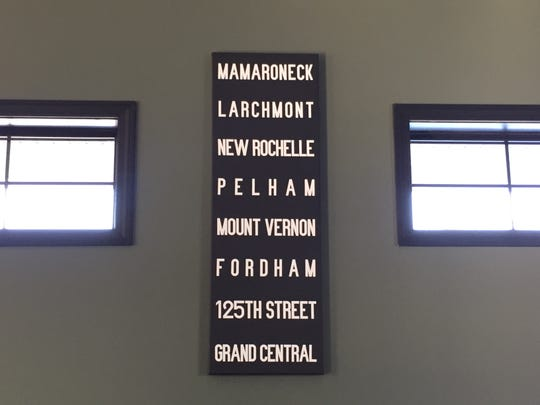 Signs behind the bar at Railroad & Main reflect the train heritage of Essex Junction.