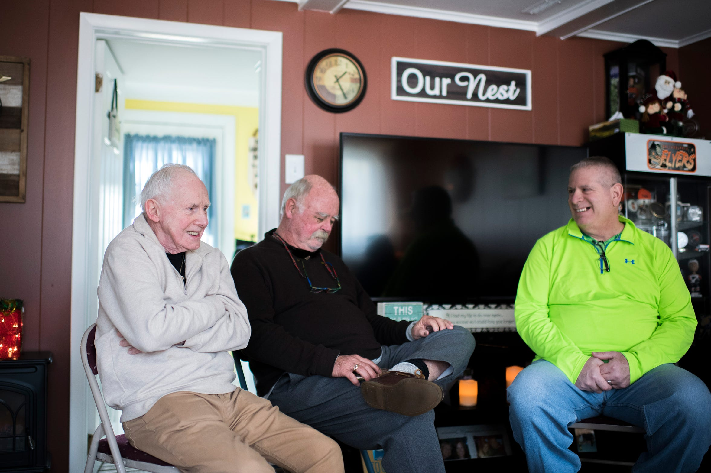 Jerry Callahan, from left, Jay Bryan and Anthony Inverso discuss newly found family relationships Wednesday, Dec. 12, 2018 in Turnersville, N.J.