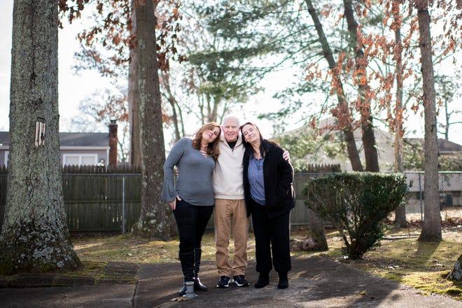 Dina Callahan, from left, Jerry Callahan and Jill Lafferty pose in Dina's backyard.