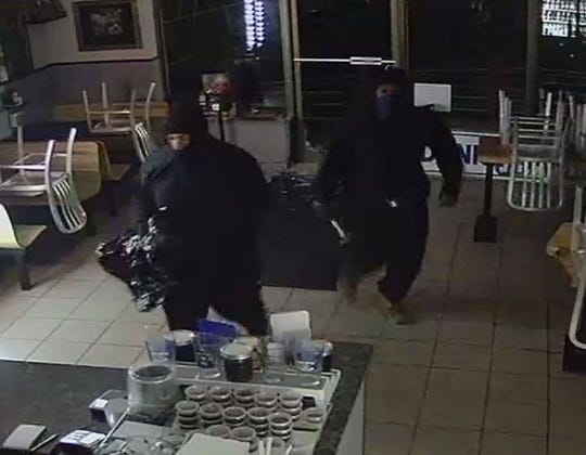 This image from a surveillance camera shows the two suspects in a burglary Wednesday at Donkey's Place Too.