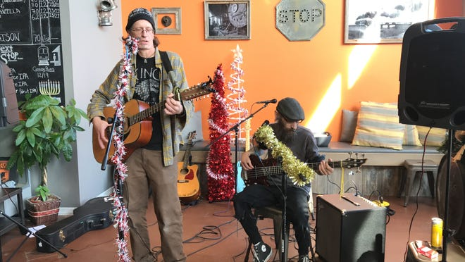 Brian Walker-Talbot (left) and Andy Basile of the Hobo-Style perform at LIVE@Lunch hosted by Carly Q. Romalino, of the Courier Post. The band spear-headed The Yuletide Motel record, an album facing some real issues at Christmas time. Record sales benefit the American Foundation for Suicide Prevention.