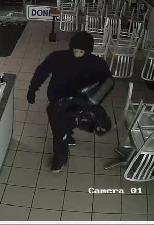 This image from a surveillance camera shows a suspect in a burglary Wednesday at Donkey's Place Too.