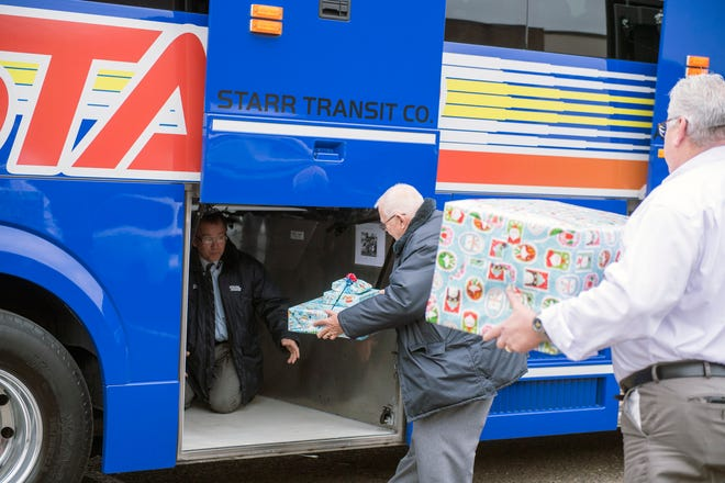 Gifts are loaded into a Starr bus headed to WVU Medicine Children's Hospital Thursday, Dec. 13, 2018 at Go4theGoal in Pennsauken, N.J.