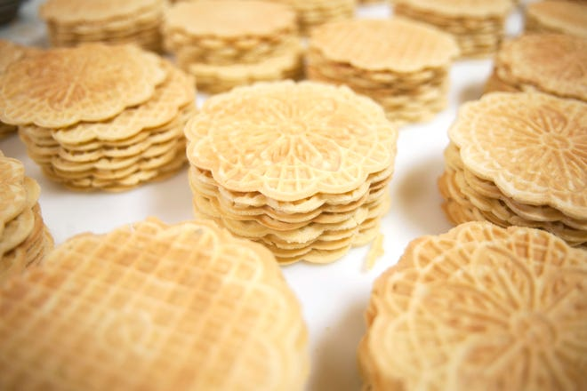 Freshly baked pizzelle are stacked in Del Buono's Pizzelle Company in Bellmawr.