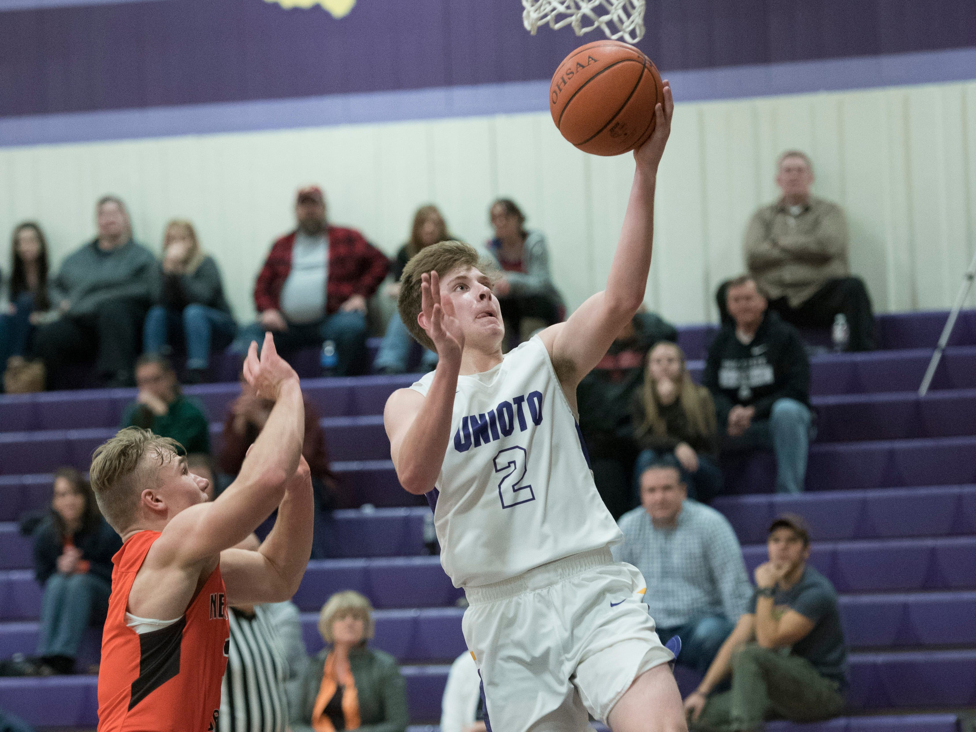 Unioto's Cameron Debord scores against Nelsonville-York Wednesday night at Unioto High School. Debord helped to clench Unioto's 66-53 win by scoring 17 points for the night.