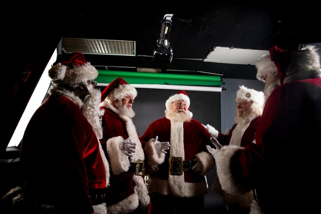 Ohio: Santas chat about SantaCon before posing for a group portrait in The Enquirer studio in Downtown Cincinnati.