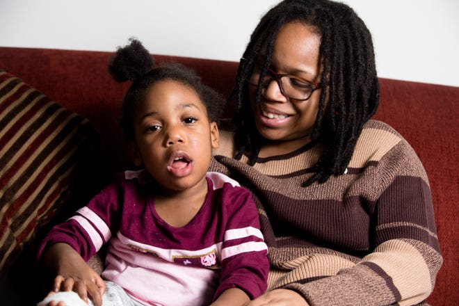 Bryce Foster sits with her 3-year-old daughter, Kaysen Blackshear, at their home in Finneytown on Thursday, Dec. 13, 2018. Kaysen has a gene disorder that has led to seizures and global development delay.