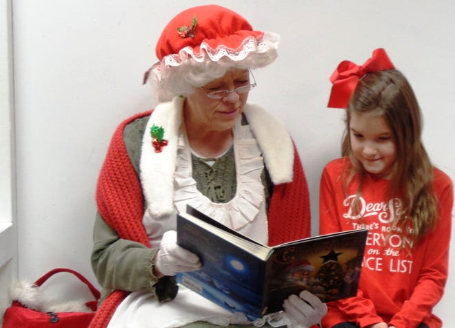 Mrs. Claus (Chris Smith) reads a Christmas story to the kids at St. Columban Knights of Columbus Christmas with Santa Dec. 7.