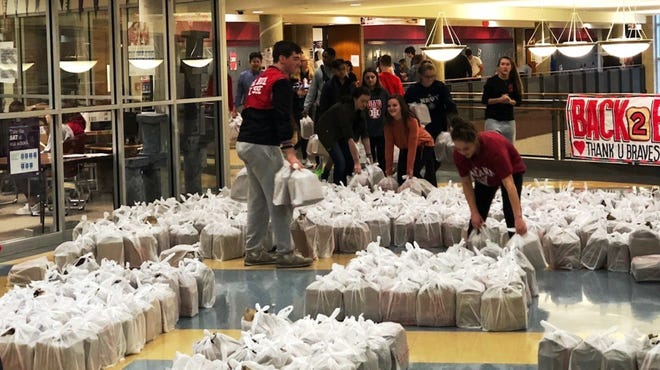 Indian Hill High School students organized a donation of 3,400 pounds of food to give to 4,000 students and their families in time for Thanksgiving.