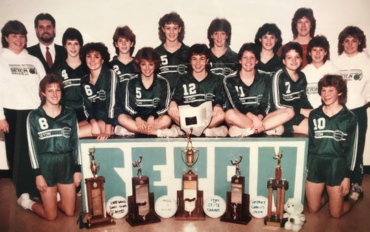 The 1984 Seton High School state volleyball champions were, from left: kneeling, Ann Fishburn and Julie Royer; sitting, Coleen Allen, Kristi Harding, Tracey Thompson, Judy Robben and Lisa Orlando; standing, manager Sharon Duwel, assistant coach Tony Esposito, Kelly Kemen, Karen Knue, Barb Mannix, Lisa Robben, Michelle Helmers, head coach Mary Jett, manager Karen Lundy and scorekeeper Kathy Huber.