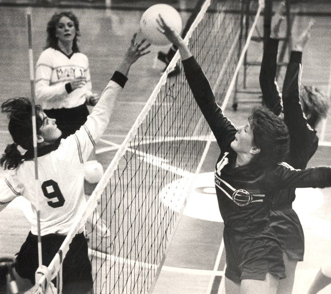 OCTOBER 28, 1984: Holly Jansen of McAuley (left) and Judy Robben of Seton go up at the net during Saturday's district championship at Forest Park High School.