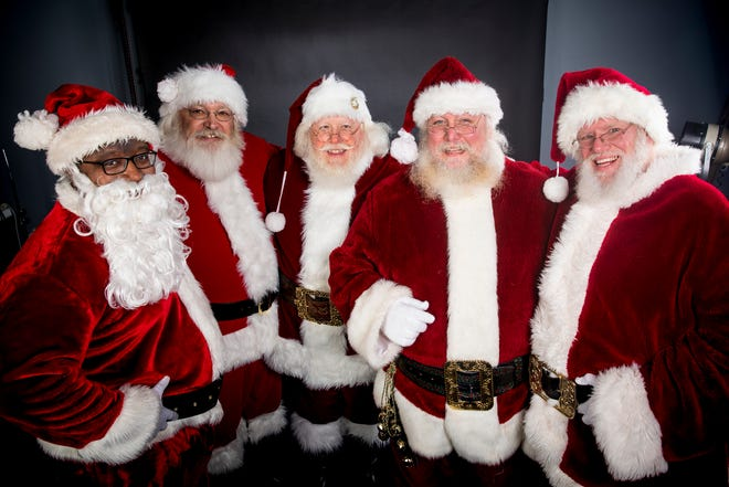 (From left to right) Santa Galen, Santa Bill, Santa Kent, Santa Jim and Santa Robert pose for a group portrait in The Enquirer studio in Downtown Cincinnati Wednesday, December 12, 2018.