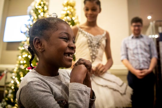 Martaisha Thomas, 7, reacts to meeting Cincinnati Ballet ballerina Salomé Tregre before the dress rehearsal of the Cincinnati Ballet's performance of the Nutcracker Wednesday, December 12, 2018 at Music Hall.