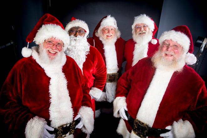 (From left to right) Santa Robert, Santa Galen, Santa Kent, Santa Bill and Santa Jim pose for a group portrait in The Enquirer studio in Downtown Cincinnati Wednesday, December 12, 2018.