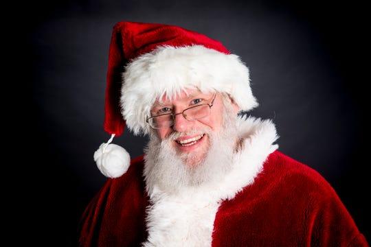 Santa Robert poses for a portrait in The Enquirer studio in Downtown Cincinnati Wednesday, December 12, 2018.
