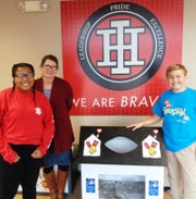 Indian Hill Middle School Principal Jennifer Ulland with students Sydney Frost and Bennett Conrad who will lead two of the student groups going to serve at 10 locations around Cincinnati May 10.