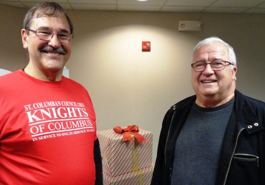 Mike Irwin and Bob St. Martin crafted a sleigh on wheels to assure Knox Smith would be able to arrive in style as Santa Claus for the Knights of Columbus Christmas with Santa at St. Columban.