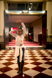 Martaisha Thomas, 7, poses in her favorite ballet posture before the dress rehearsal of the Cincinnati Ballet's performance of the Nutcracker Wednesday, December 12, 2018 at Music Hall.